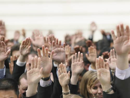 people raising their hands to say they are interested in writing a book