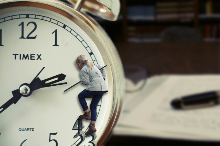 woman holding hands of clock